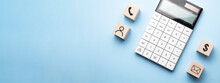 Financial Concept With Icons On Wooden Cubes, Calculator On Blue Background. Phone,mailing,person And Dollar Sign