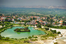 Lake And Natural Carbonate Formations On A Mountain In Pamukkale, Turkey