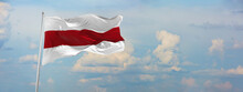 Flag Of Belarus At Cloudy Sky Background On Sunset, Panoramic View. Patriotic Concept About Belarus And Copy Space For Wide Banner. 3d Illustration