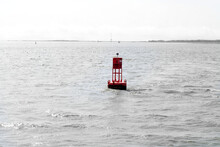 A Red Buoy In The Water