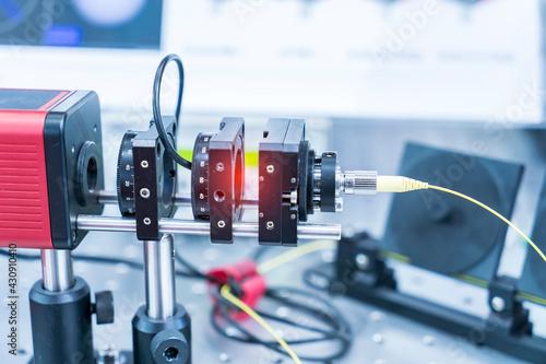 Fototapeta Experiment with laser device in optical laboratory obraz
