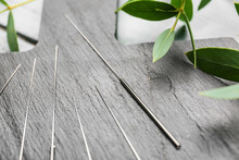Acupuncture Needles On Wooden Board, Closeup