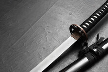 Katana Sword On The Black Table Background With Copy Space.