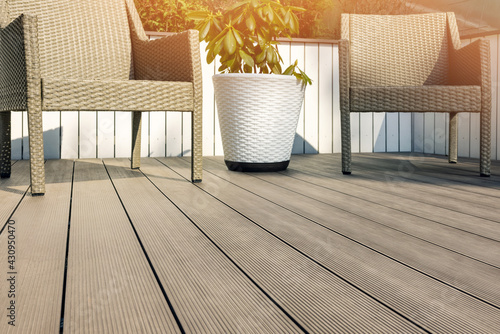 Fototapeta furnished outdoor terrace with wpc wood plastic composite decking boards