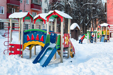 The Playground In The City's Residential Courtyard Is Built For The Development And Entertainment Of Children. The Playground Is Covered With Snow During The Winter Season.