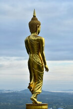 """Behind A Large Golden Buddha Image Standing On The Base Of Lotus Flower. """"Wat Phra That Khao Noi"""",Nan Province, Thailand.Which A Buddha Image In The Buddha Statue, Hair Made Of Gold Spiral Pattern."""
