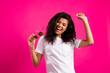 Leinwandbild Motiv Portrait of attractive carefree cheerful girl enjoying having fun dancing isolated over vivid pink fuchsia color background