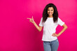 Leinwandbild Motiv Photo of cute brunette student young lady point empty space wear white t-shirt isolated on vivid pink color background