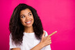 Leinwandbild Motiv Portrait of attractive cheerful girl demonstrating copy space like follow subscribe isolated over vivid pink fuchsia color background