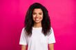 Leinwandbild Motiv Portrait of attractive cheerful girl wearing white tshirt isolated over vivid fuchsia color background
