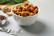 Tasty Marinated Mushrooms In Bowl On Grey Table, Closeup