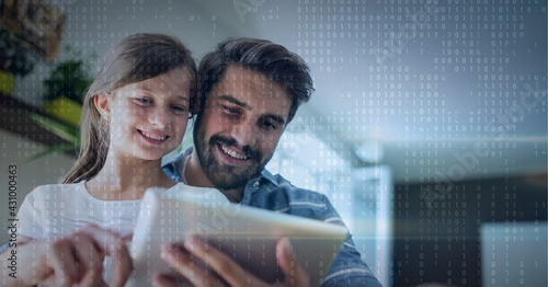 Binar code pattern over father and daughter smiling using tablet