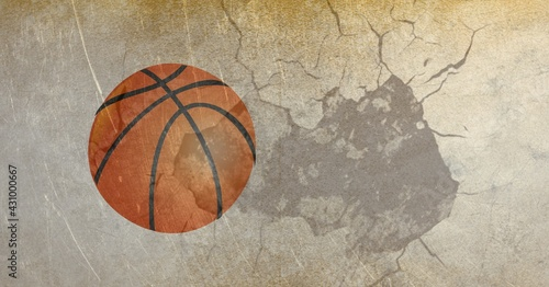 Composition of basketball in air over cracked distressed surface
