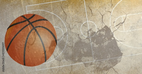 Composition of basketball in air over basketball court cracked distressed surface