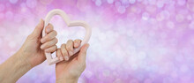 Give It All Your Heart Message Background - Female Hands Holding A Pale Pink Heart Shaped Frame Against A Pink Lilac Bokeh Background With Copy Space For Messages