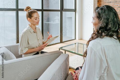 Wallpaper Mural Female coach interviewing her trainee indoor