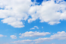 Blue Sky With Cumulus Clouds. White Clouds Like Cotton Wool. Beautiful Sky On A Hot Sunny Day
