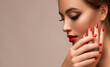 canvas print picture - Beautiful woman showing red lips and   manicure nails .Blue eyed  model girl .  Evening bright makeup . Beauty , make-up and cosmetic