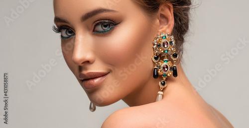 Stampa su Tela Beautiful woman with long big earrings