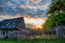 Sunset Over The House And Green Trees In The Countryside