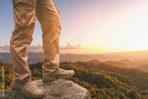 Canvastavla Hiker standing on top mountain sunset background