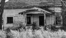 Front Door Of Old Creepy Farm House In Black And White