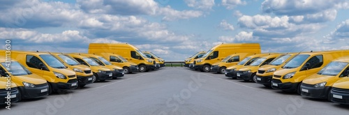 Fotografie, Obraz Yellow delivery vans parked in a rows