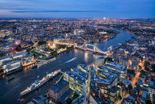 Aerial View Of London At Night With Thames River And Tower Bridge