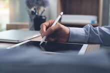 E-signing, Electronic Signature Concept. Businessman Hand Using Stylus Pen Signing On Digital Tablet On Office Table
