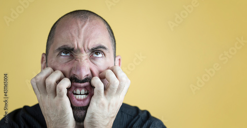 Fotografie, Obraz Portrait of angry insane man isolated on yellow background