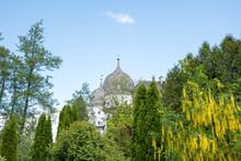 Beautiful Castle Schwindegg, View Between Green Trees In Summer