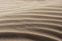 Background Image Of Close-up Yellow Waves Of Sand In Nature Park Of Jandia On Deserted Island Fuerteventura