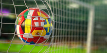 Football Ball With Flags Of European Countries In The Net Of Goal Of Football Stadium. Euro Championship 2021.