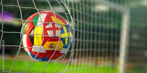 Football ball with flags of european countries in the net of goal of football stadium. Euro championship 2021. - fototapety na wymiar