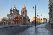 Early Morning In Moscow, The First Rays Of The Sun. View Of The Red Church With Golden Domes. Empty Street With Lanterns