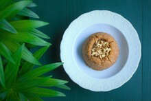 Semolina Halva With Walnuts In A White Porcelain Plate