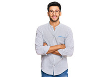 Young Handsome Man Wearing Casual Clothes And Glasses Happy Face Smiling With Crossed Arms Looking At The Camera. Positive Person.