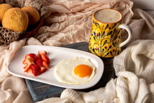 Fried Egg With Chopped Strawberries And Cocoa Drink