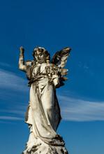 Angel Statue Against A Blue Sky (upward Angle)