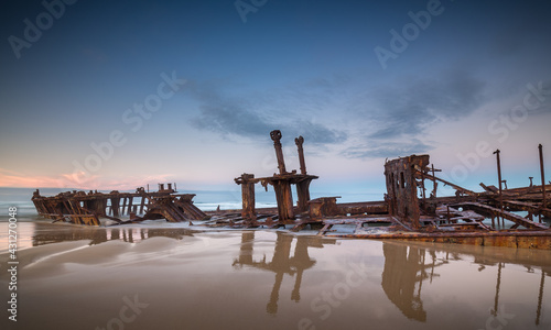 Fotografie, Obraz Wreck of the Steam Ship SS Maheno covered by sand on the beach