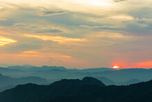 Sunset Or Evening Time Over The Mountains Hill Valley With Beauty Clouds.