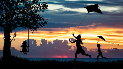 Sylwetki dzieci bawiących się latawcem i na huśtawce