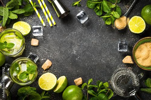 Fototapeta Mojito cocktail on black stone background top view. obraz