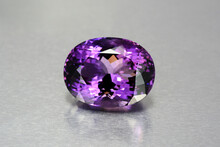 Natural Mined Deep Purple Violet Color Oval Faceted Huge Amethyst Loose Gemstone From Uruguay. Perfect Shape, Cut. Clean, Flawless, Transpaent Gem Setting For Making Jewelry. Aluminium Background.
