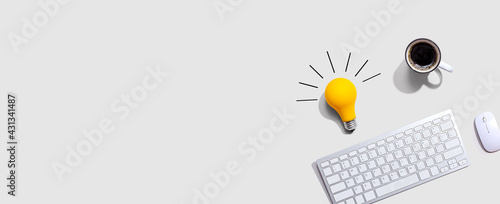 Computer keyboard with a yellow light bulb