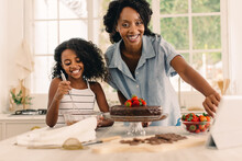 African Woman With Daughter Making A Birthday At Home