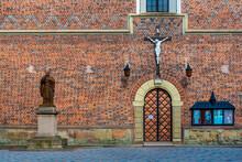 DROHOBYCH, UKRAINE - April 25, 2021: Monument To Pope John Paul II And Crucifix On The Wall Of The Roman Catholic Church Of St. Bartholomew.