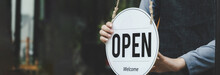 Wide Banner. Reopen. Waitress Hand Turning Open Sign Board On Glass Door In Modern Cafe Coffee Shop Ready To Service, Cafe Restaurant, Retail Store, Small Business Owner, Food And Drink Concept