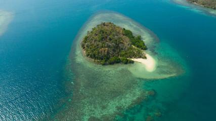 Tropical island with sandy beach on the Zamboanga Peninsula. Sallangan Island. Mindanao, Philippines.