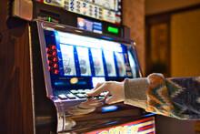 Playing Slot Machine In Las Vegas Casino